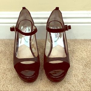 Black platform peep toe pumps